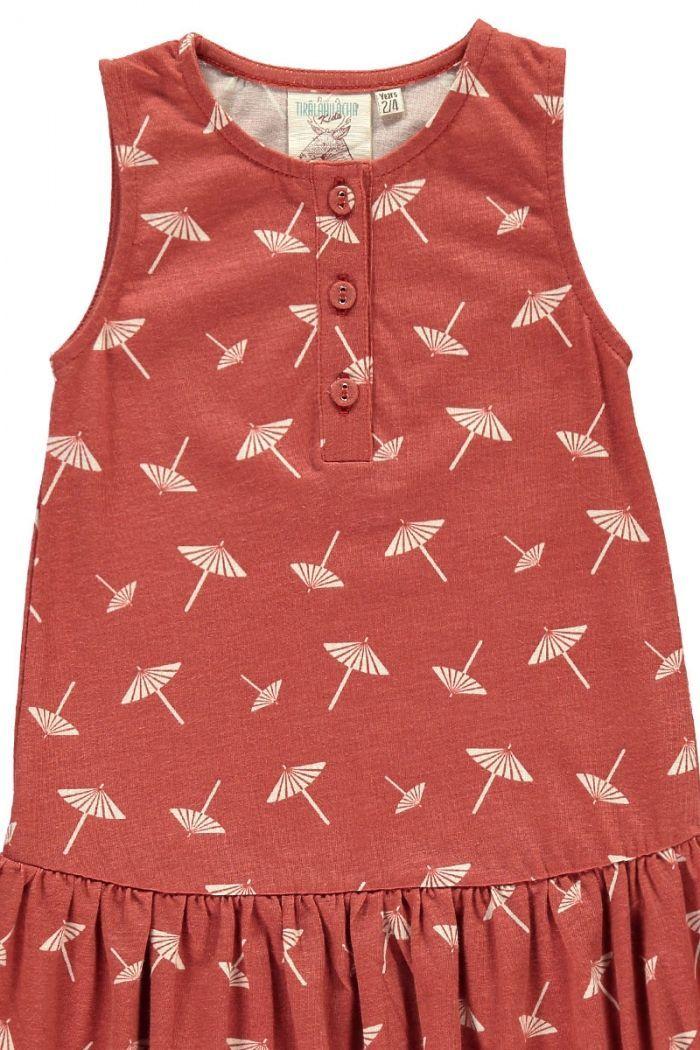 Detalle vestido infantil charlestón terracota estampado