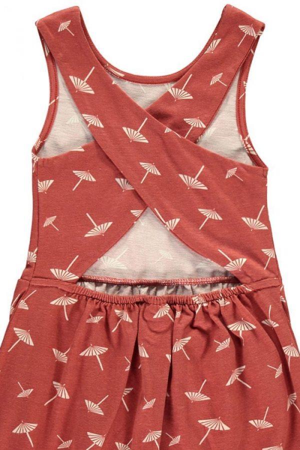 Detalle vestido infantil espalda cruzada terracota estampado sombrillas