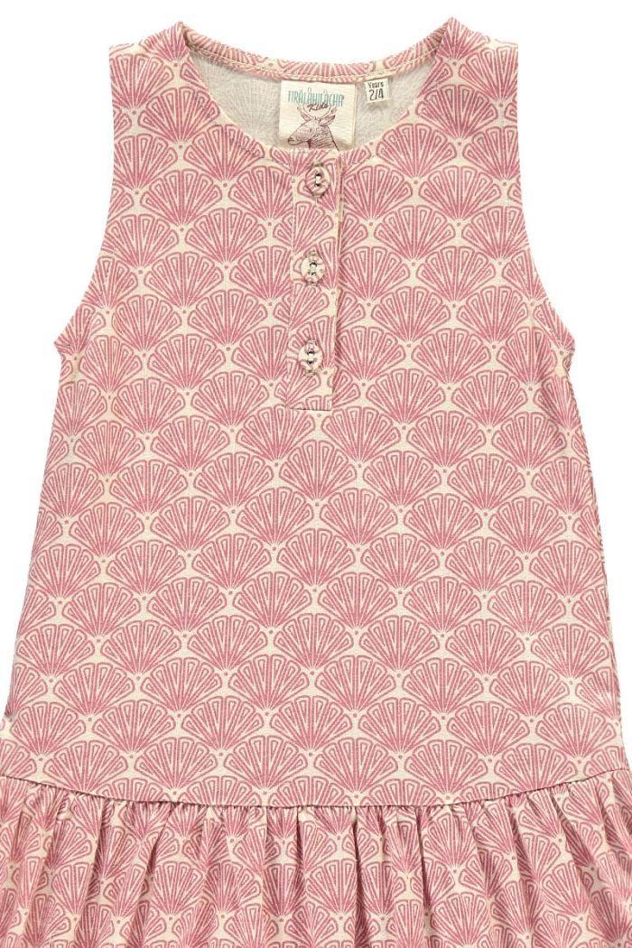 Detalle vestido infantil charlestón salmón estampado abanicos