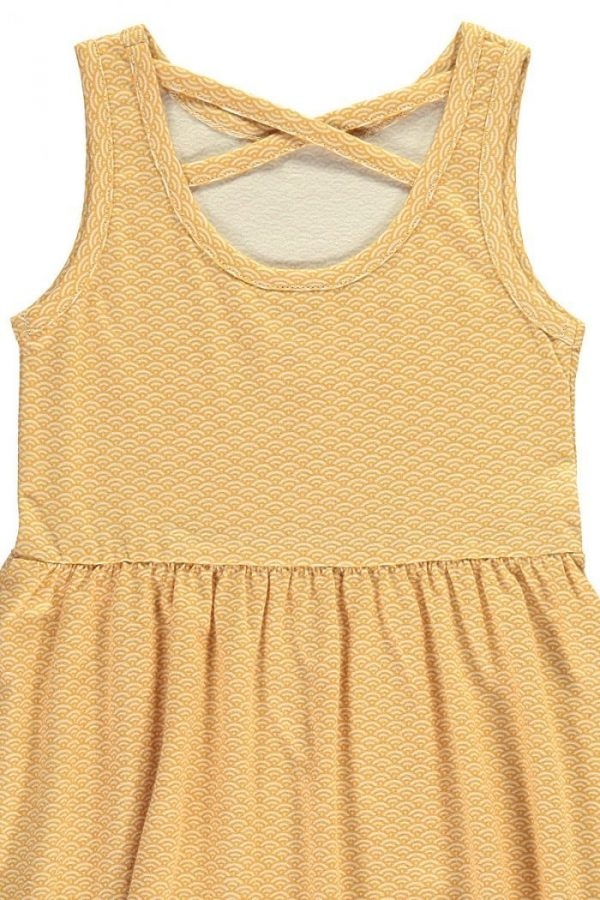 Detalle vestido infantil tirantes amarillo estampado japonés