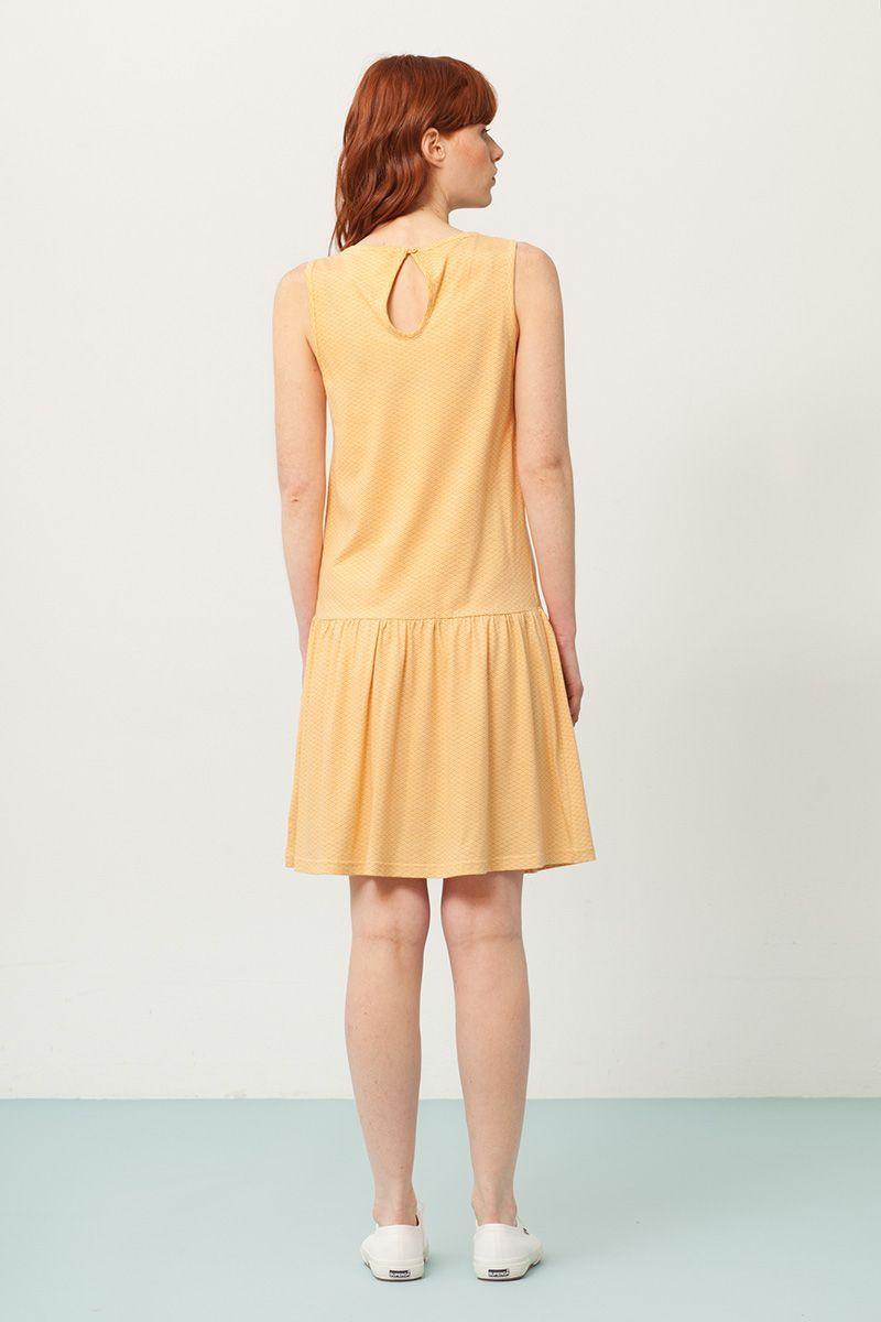 Espalda vestido charlestón amarillo estampado abanicos