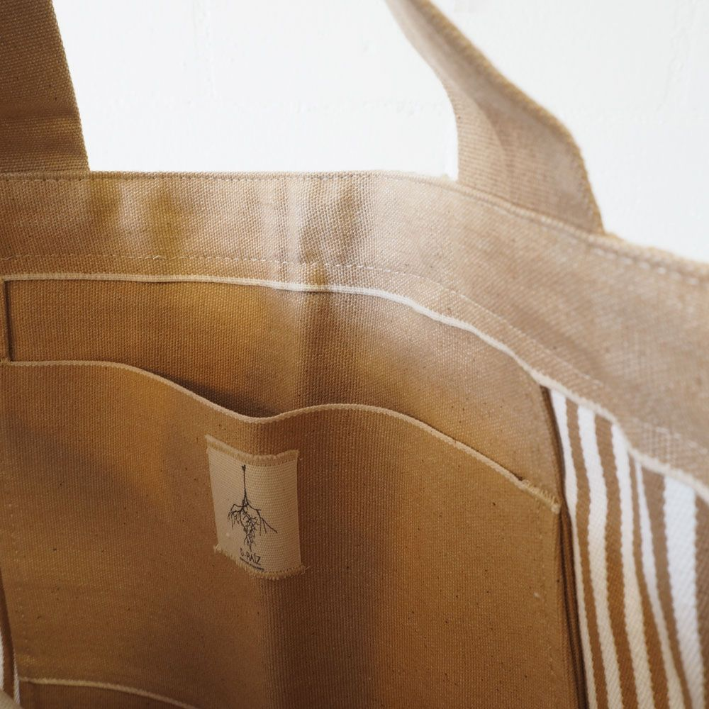 Bolsillo interior bolso playa de rayas beige