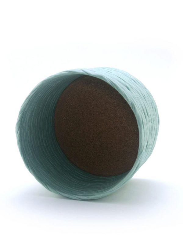 Interior cubremacetas de tela reciclada verde