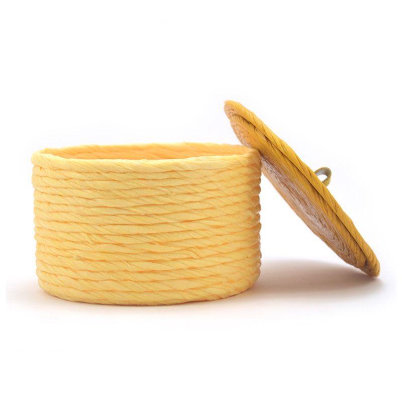 Cajita de tela amarilla tapa abierta