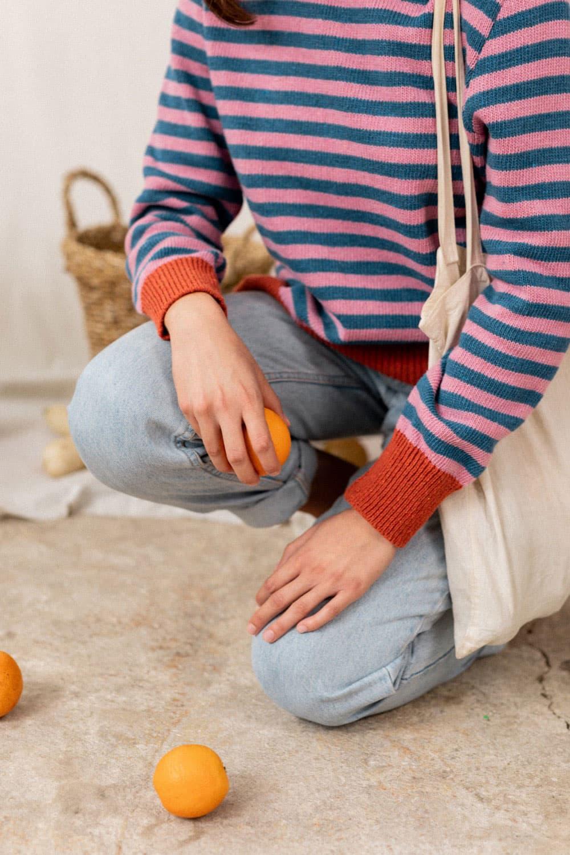 Puños naranja jersey sostenible mujer