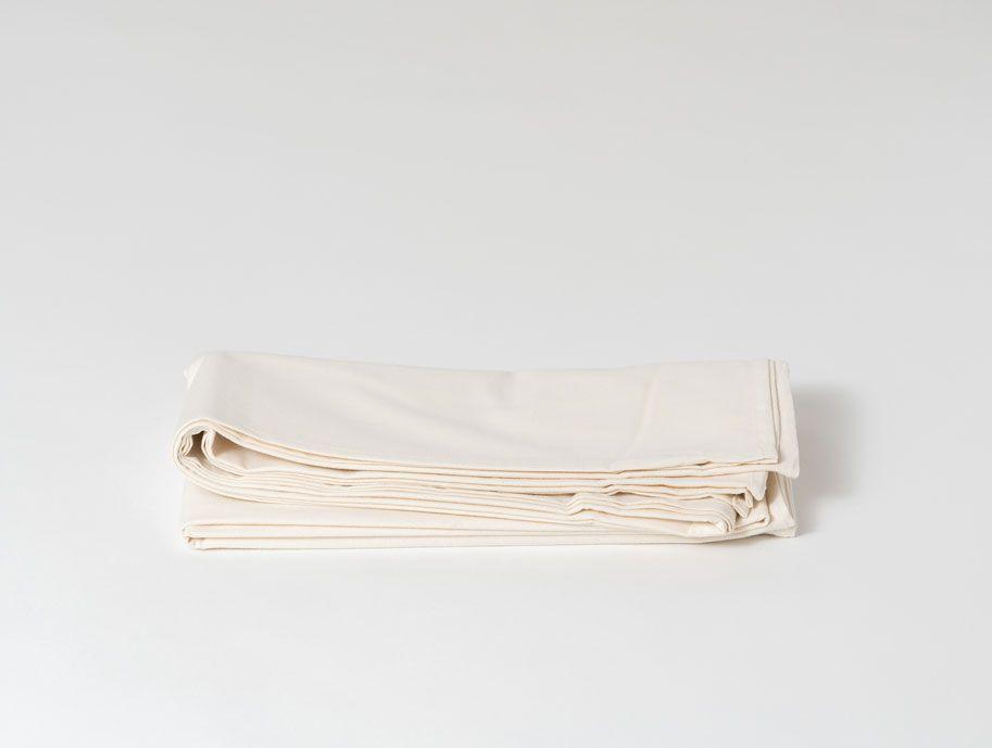 Mantel de tela color hueso