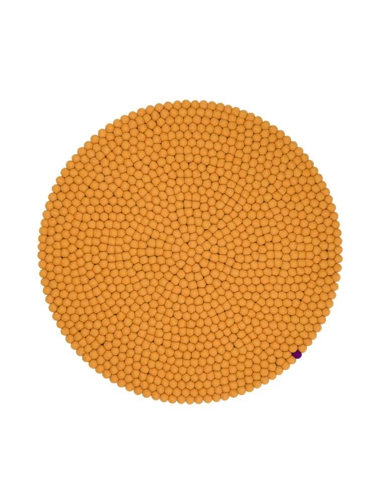 Alfombra circular color ocre-amarillo