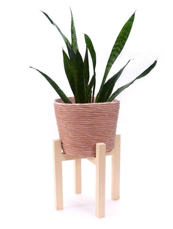 Cubremacetas rosa con soporte para planta