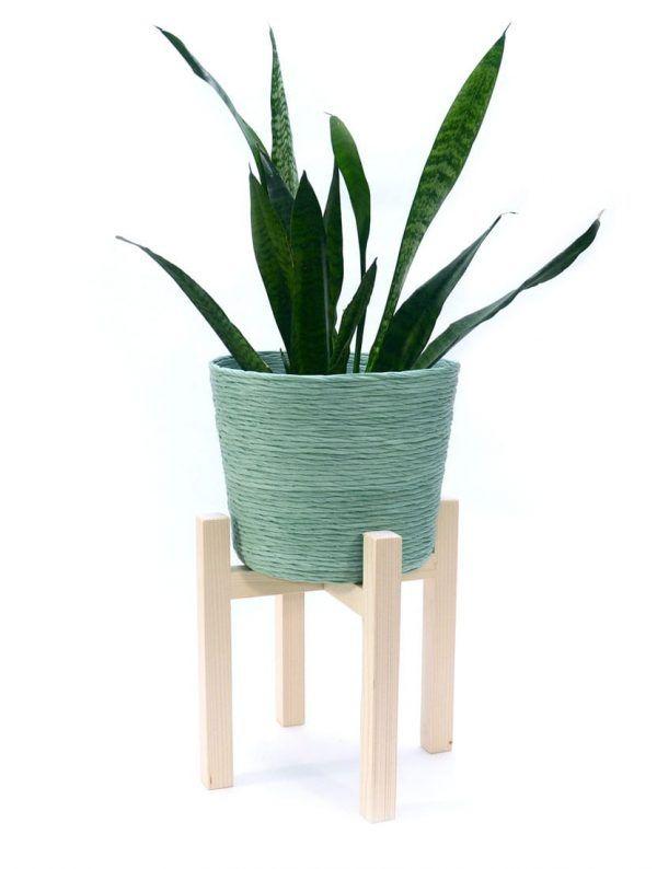 Cubremacetas verde con soporte para planta