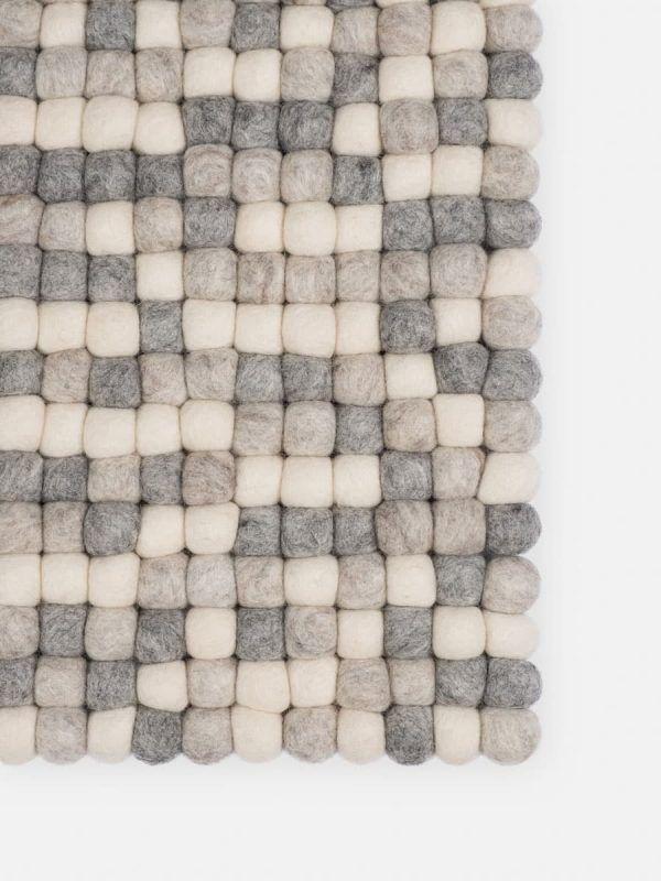 Detalle alfombra colores natural claro